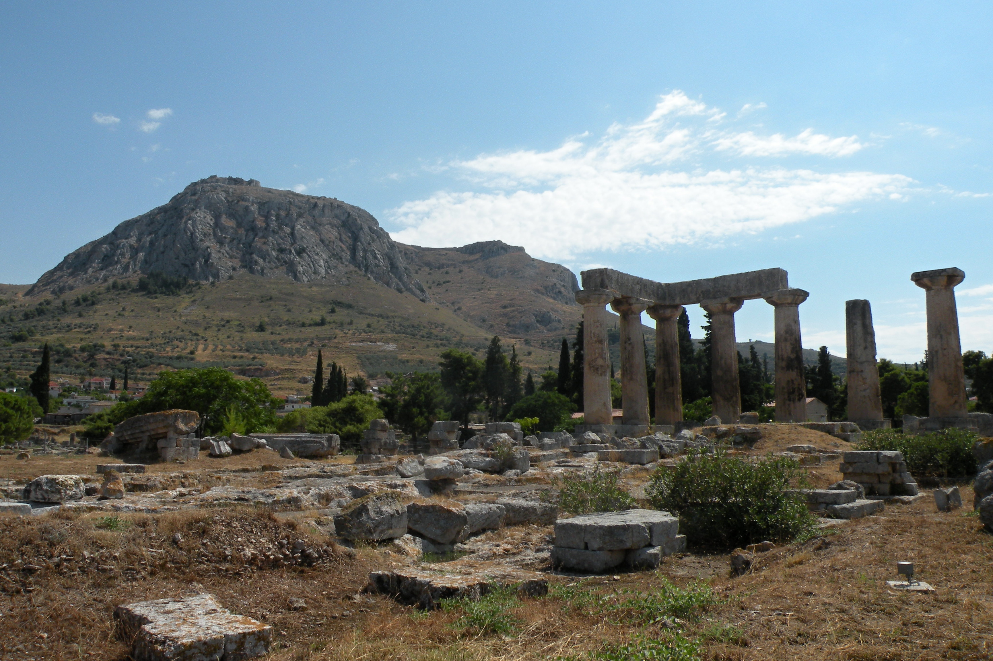 The Temple of Apollo at Corinth with the acropolis in the distance
